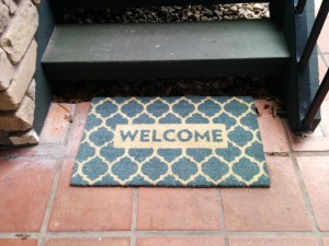 Welcome Mat at the Bottom of Staircase leading to Suite 303